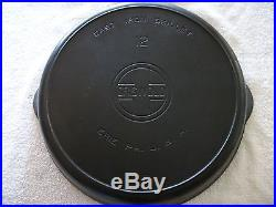 A+ CAST IRON GRISWOLD SKILLET NUMBER 12 LARGE LOGO WITH HEAT RING