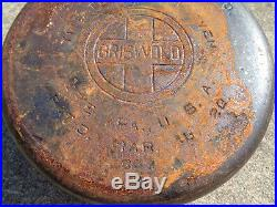 Cast iron Griswold No. 8 Tite Top Dutch oven (rusty bottom) & lid. No reserve