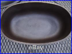 HTF GRISWOLD No 3 FULLY MARKED DUTCH OVEN OVAL ROASTER WITH TRIVET, CAST IRON